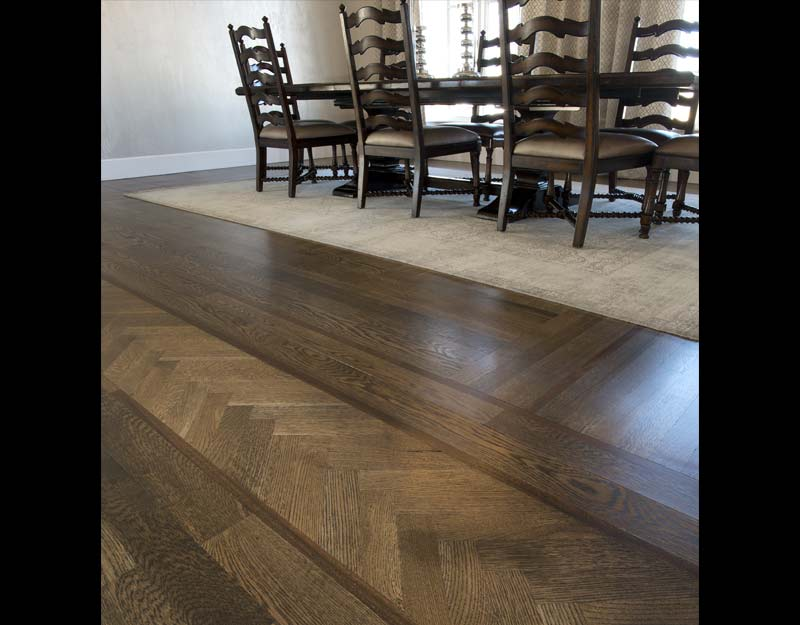 White Oak Flooring with Walnut Feature Strip and Herringbone Border